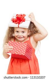 funny happy child girl opening gift box