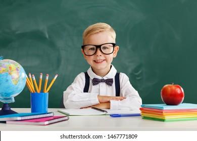 funny happy child   schoolboy  boy student about school blackboard