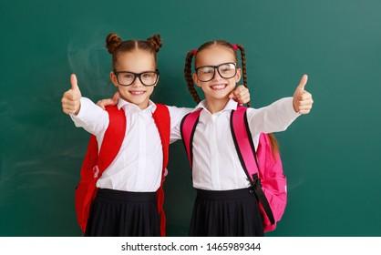 funny happy children   schoolgirls  girls twins students about school blackboard