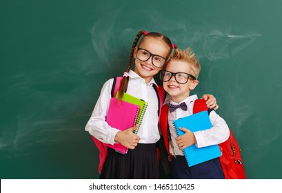 funny happy group children   schoolboy  and schoolgir, student boy  and girl about school blackboard