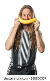 Funny, happy hippie man holding a banana over his mouth as a smile. Isolated on white.