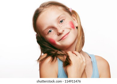 Funny happy little girl posing on white background.