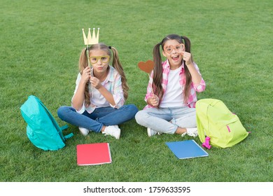 funny and happy sisters with party attributes. writing girlish diary. childhood memories. having rest after school day. spring holiday time. best friends forever. pass exam with success.