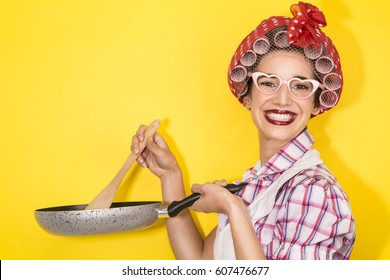 funny housewife cooking on yellow background