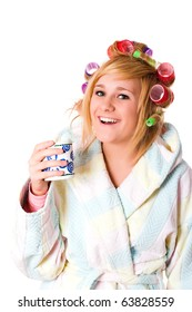 funny housewife with curlers and cup on white background