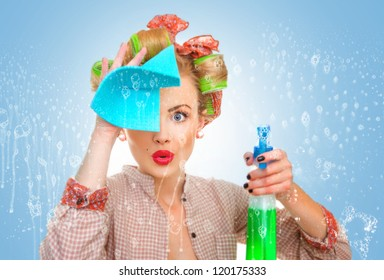 Funny housewife with rag / wipe and cleaning spray for window. Foam / soap on glass