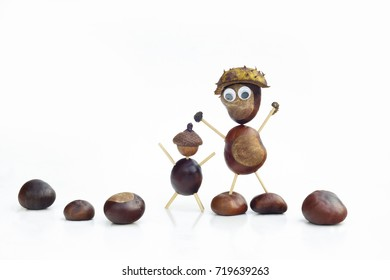 Funny human shape character or figurine made with chestnuts in white isolated background.