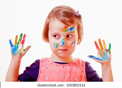 Funny image of cute little child girl with colorful painted hands. (art, childhood, color, creativity concept)