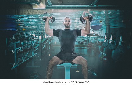 funny image of man training with dumbbell in a flooaded gym
