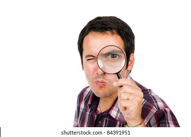 Funny image of a young man looking through magnifying glass, isolated on white
