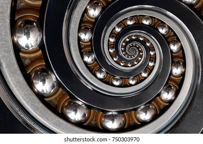Funny incredible unrealistic surreal industrial Ball Bearing spiral abstract pattern background. Spiral machinery abstract surreal pattern background. Spiral effect technology. Ball bearing fractal