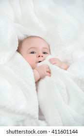 Funny infant in white cloth. On a white background.