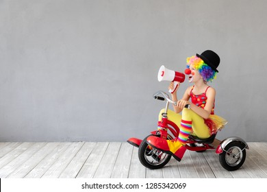 Funny kid clown. Happy child playing at home. 1 April Fool's day concept