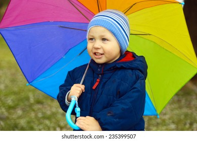 funny kid with a   colored umbrella