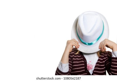 Funny kid covering her face with hat
