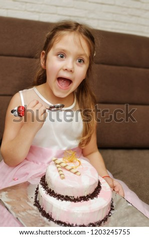 Funny Kid Girl Eating Birthday Cake With Open Mouth