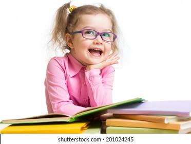 Funny kid girl in glasses reading books