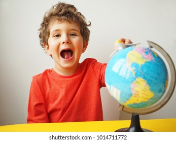 Funny kid laughing with globe and airplane