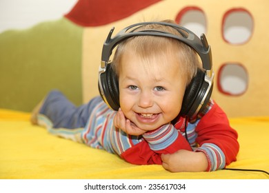 funny kid listening to music in headphones