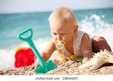 funny kid playing  on the beach