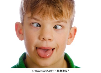 Funny kid with a silly expression on his face.