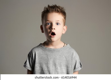 funny kid.handsome little boy.surprised 7 years old child