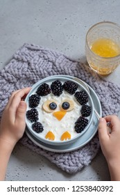 Funny kids breakfast coconut rice porridge with fresh berries