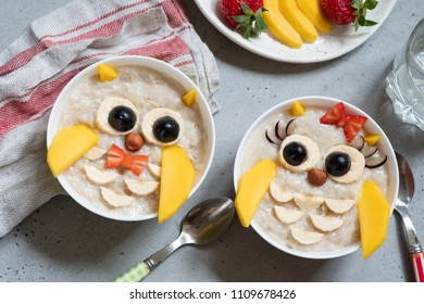 Funny kids breakfast porridge with fruits and nuts