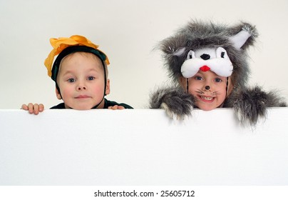 Funny kids faces above big blank sheet of paper