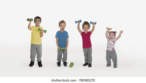 Funny kids lifting weights isolated on white background