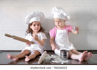 Funny kids are preparing the dough in the kitchen. happy family