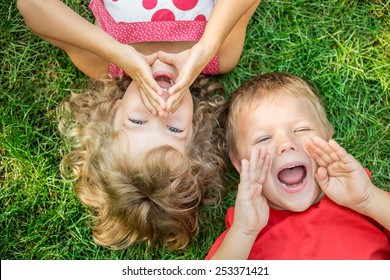 Image of: Funny Vines Funny Kids Shouting Outdoors Happy Children Lying On Green Grass Communication Concept Aliexpress Funny Kids Images Stock Photos Vectors Shutterstock