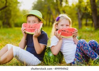 Funny kids taste watermelon. Child Healthy Eating