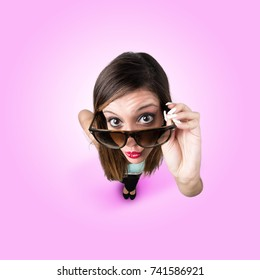 Funny Kissing Girl with Sunglasses looks like caricature of herself, fish eye lens shot