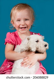 funny laughing girl with white puppy