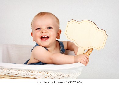 Funny laughing toddler with notice board