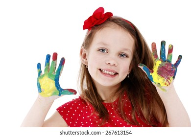Funny little artist with dirty hands - isolated studio portrait
