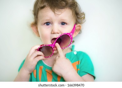 Funny little baby with glasses