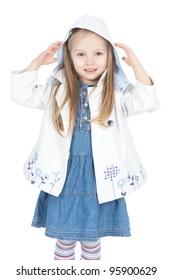 Funny little blonde girl in white raincoat over white