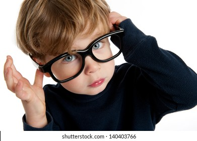 Funny little boy with big glasses shot in the studio on a white background.