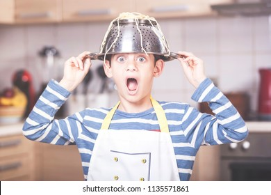 Funny little boy chef has a kitchen accident