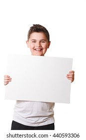 Funny little boy holding a large white plate for your text in the studio on an isolated white background