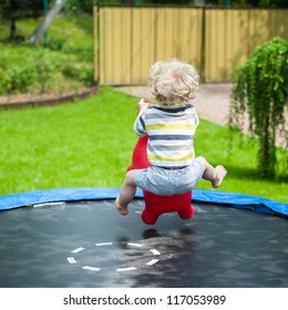 Funny little boy on trampoline