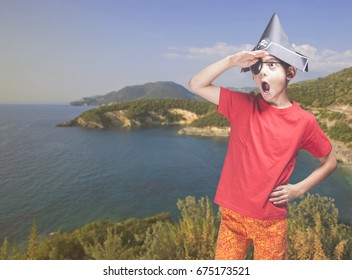 Funny little boy playing pirates on an island