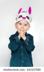 Funny little boy in rabbit  mask for holiday Easter