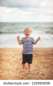 Funny little boy at the sea