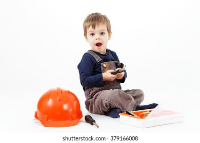 Funny little boy with tools kit on white background