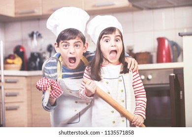 Funny little chefs screaming in the kitchen