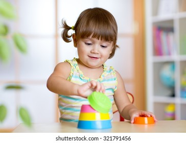 Funny little child playing with educational toys