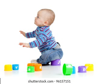 Funny little child is playing with toys, isolated over white